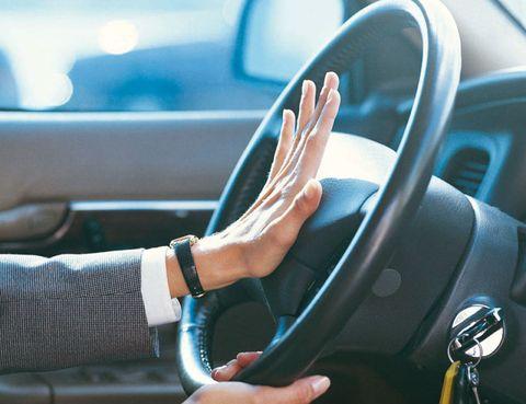 Motor vehicle, Automotive design, Steering part, Vehicle door, Steering wheel, Hand, Wrist, Fixture, Luxury vehicle, Automotive mirror,
