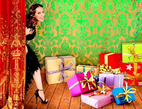 Human, Black hair, Couch, Bag, Gift wrapping, Living room, Ribbon, Present, Long hair, Paper product,