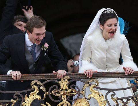 Bridal veil, Happy, Bridal clothing, Suit, Veil, Facial expression, Coat, Formal wear, Bride, Fashion accessory,
