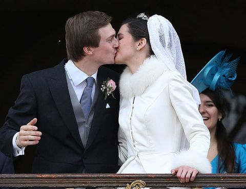 Clothing, Coat, Forehead, Bridal veil, Photograph, Suit, Outerwear, Kiss, Happy, Formal wear,