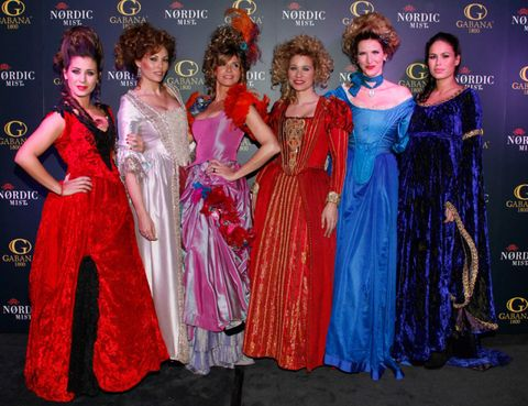 Clothing, Event, Dress, Red, Formal wear, Gown, Headgear, Fashion, Public event, One-piece garment,