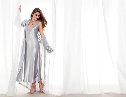 Textile, Foot, Sandal, Fashion design, Costume, Ankle, Linens, Photo shoot, Curtain, Costume design,