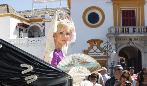 Nose, Hat, Fashion accessory, Headgear, Temple, Sunglasses, Sun hat, Tradition, Makeover, Wig,