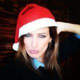 Lip, Hairstyle, Eyebrow, Red, Headgear, Costume accessory, Carmine, Costume hat, Costume, Long hair,