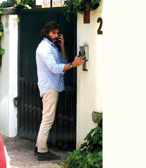 Green, Dress shirt, Door, Street fashion, Home door, Houseplant,