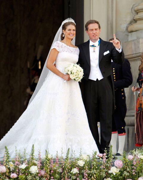 Clothing, Petal, Trousers, Dress, Bridal clothing, Coat, Photograph, Wedding dress, Bride, Outerwear,