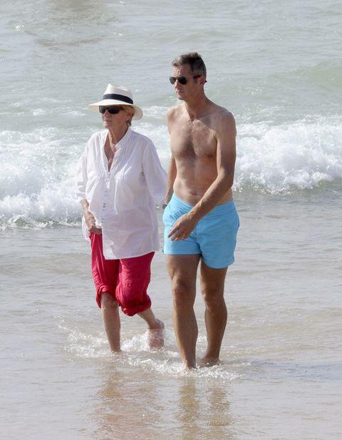 Eyewear, Vision care, Fun, Human body, People on beach, Sunglasses, Goggles, Water, Hat, Standing,