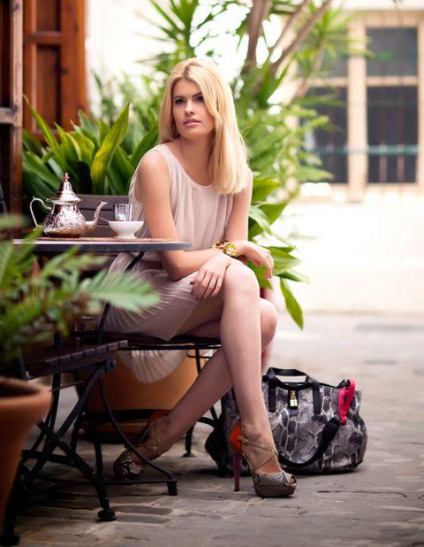 Human leg, Sitting, Flowerpot, Dress, Houseplant, Bag, Street fashion, Long hair, Foot, Door,