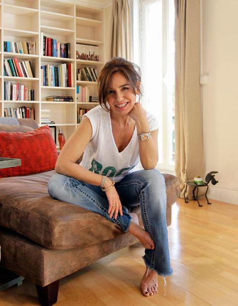 Clothing, Flooring, Floor, Interior design, Comfort, Jeans, Human leg, Shelf, Room, Sitting,