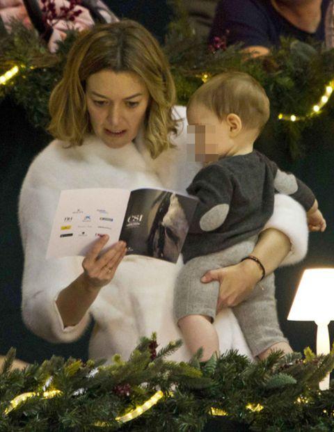 Human, Holiday, Interior design, Christmas decoration, Love, Christmas, Reading, Christmas eve, Living room, Lap,