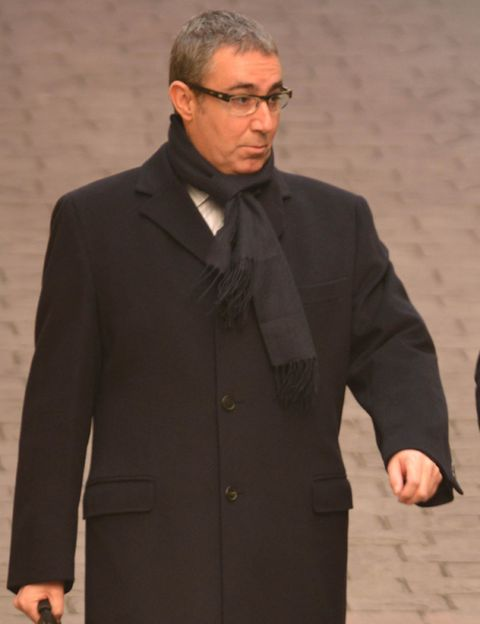 Clothing, Glasses, Coat, Dress shirt, Collar, Sleeve, Human body, Standing, Outerwear, Formal wear,