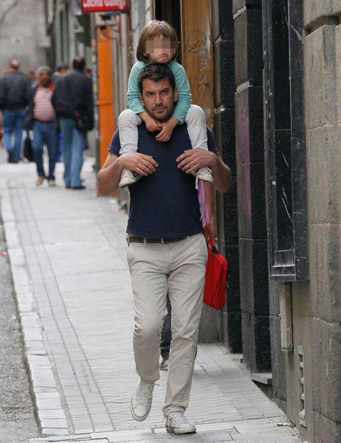 Standing, Street, Street fashion, Luggage and bags, Bag, Snapshot, Sidewalk, Pedestrian, Handbag, Cobblestone,