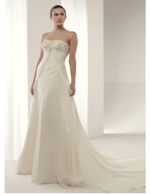 Clothing, Dress, Bridal clothing, Shoulder, Textile, Photograph, Joint, Standing, Gown, White,