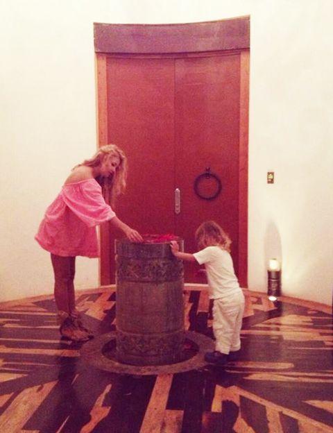 Standing, Floor, Flooring, Door, Wood stain, Blond, Varnish, Boot, Home door, Door handle,