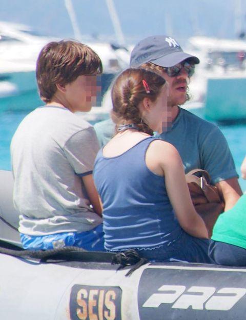 Cap, Baseball cap, Goggles, Sunglasses, Sleeveless shirt, Active tank, Cricket cap, Boating, Number, Boat,