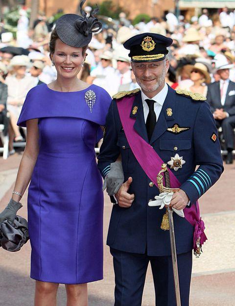 Dress, Hat, Formal wear, Suit trousers, Headgear, Purple, One-piece garment, Electric blue, Blazer, Cobalt blue,
