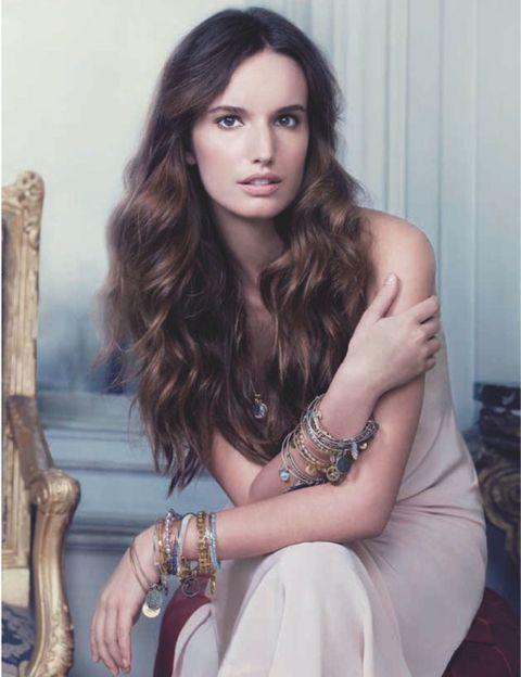 Human, Wood, Hand, Wrist, Joint, Eyelash, Fashion accessory, Sitting, Beauty, Long hair,