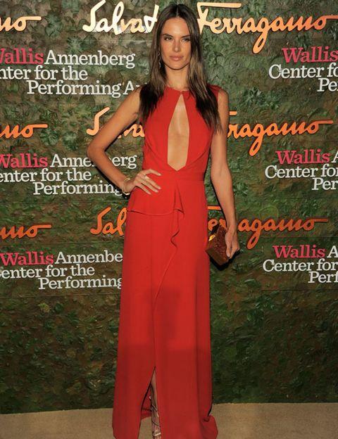 Formal wear, Style, Dress, Orange, Fashion model, Poster, Long hair, Waist, One-piece garment, Fashion design,