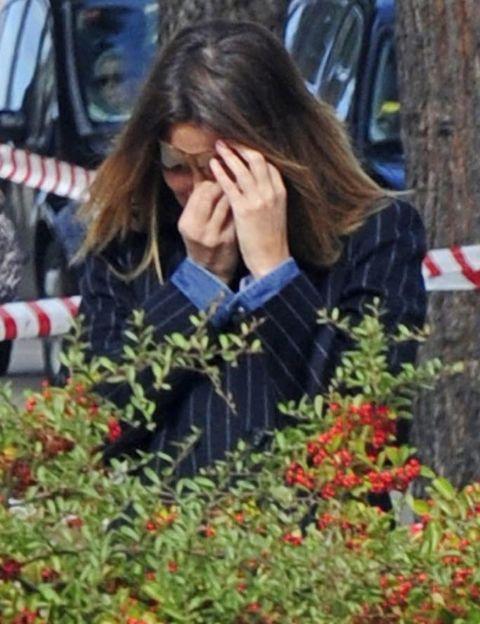 Human, Flower, Carmine, Shrub, Long hair, Coquelicot, Automotive window part, Floristry, Annual plant, Wildflower,