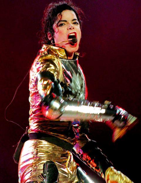 Music artist, Musician, Artist, Performance art, Jheri curl, Costume, Boot, Sword, Singing, Singer,