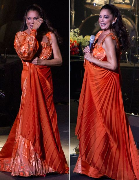 Textile, Red, Formal wear, Dress, Style, Amber, Orange, Fashion accessory, Beauty, Gown,