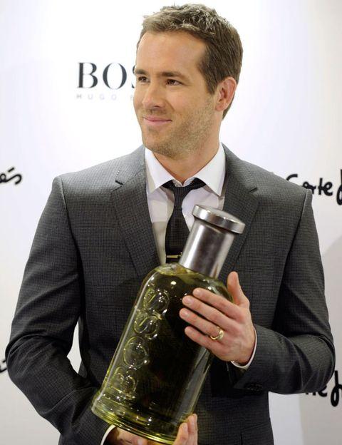 Coat, Dress shirt, Outerwear, Suit, Formal wear, Drinkware, Collar, Bottle, Blazer, Glass bottle,