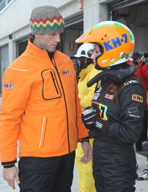 Personal protective equipment, Jacket, Cap, Winter, Orange, Headgear, Logo, Beanie, Glove, Knit cap,