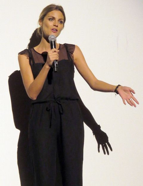 Microphone, Audio equipment, Arm, Finger, Product, Sleeve, Shoulder, Hand, Standing, Joint,