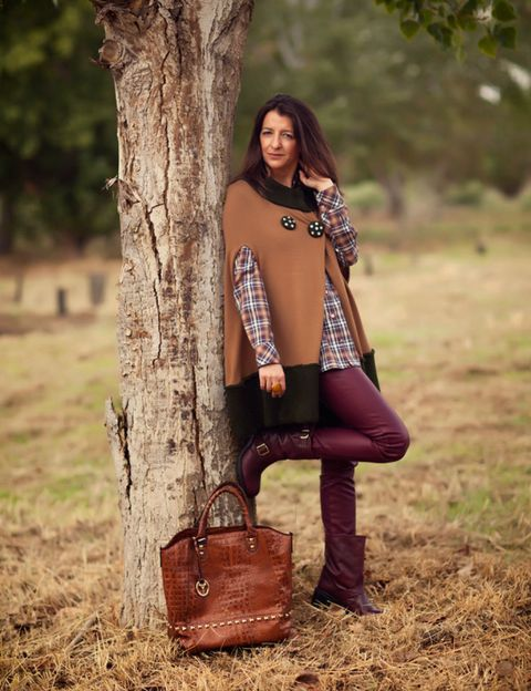 Clothing, Brown, Sleeve, Human body, Shoulder, Bag, Outerwear, People in nature, Fashion accessory, Style,