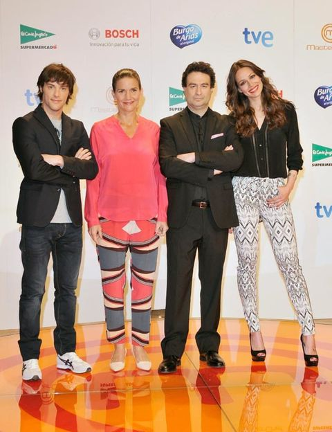 Trousers, Shirt, Outerwear, Coat, T-shirt, Orange, Fashion, Logo, Suit trousers, Fashion design,