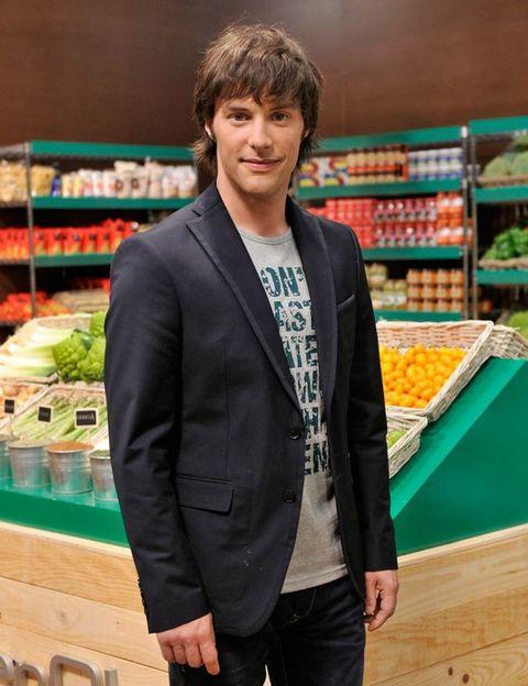 Product, Retail, Dress shirt, Shirt, Textile, Standing, Whole food, Supermarket, Coat, Marketplace,
