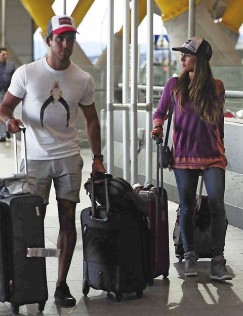 Arm, Standing, Hat, Headgear, Luggage and bags, Travel, Jacket, Street fashion, Baggage, Sun hat,