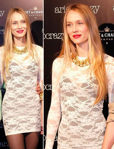 Lip, Hairstyle, Facial expression, Style, Beauty, Logo, Fashion accessory, Blond, Dress, Long hair,