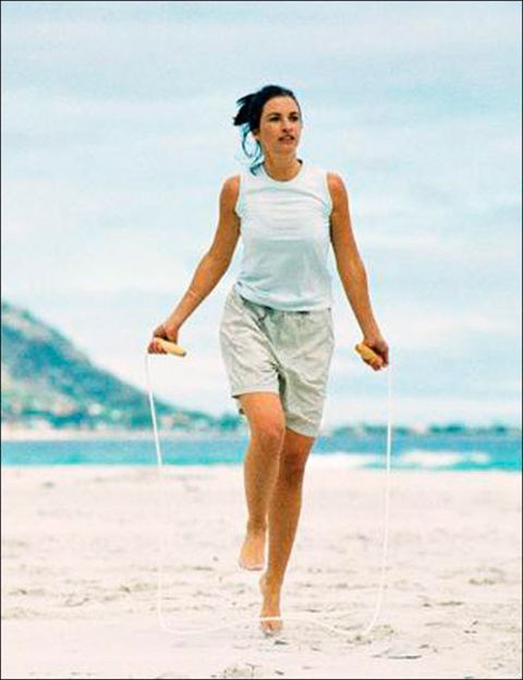People on beach, Standing, Photograph, Human leg, Joint, People in nature, Leisure, Summer, Sleeveless shirt, Vacation,