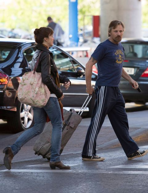 Clothing, Footwear, Leg, Land vehicle, Trousers, Shirt, Street, Human leg, Outerwear, Jeans,