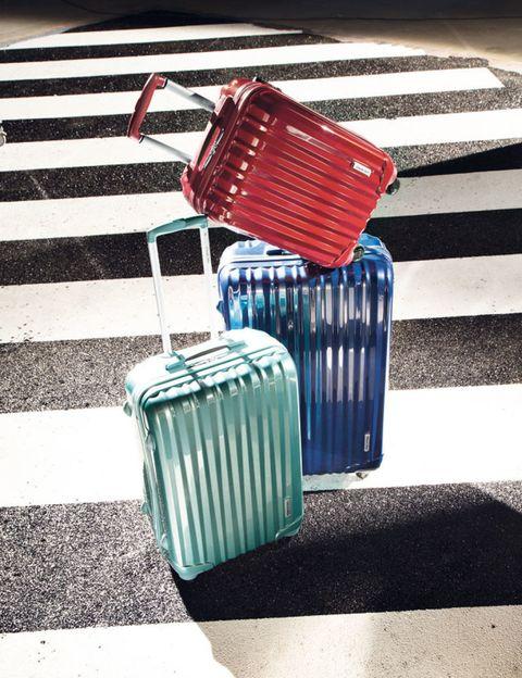 Line, Teal, Aqua, Folk instrument, Asphalt, Turquoise, Accordion, Parallel, Electric blue, Waste container,