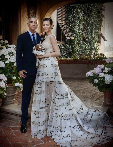 Clothing, Dress, Coat, Trousers, Flowerpot, Petal, Bridal clothing, Photograph, Outerwear, Suit,