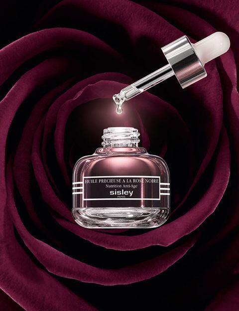 Liquid, Perfume, Red, Fluid, Bottle, Magenta, Still life photography, Cosmetics, Glass bottle, Medical equipment,