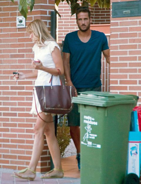 Leg, Green, Brick, Waste container, Bag, Brickwork, Waste containment, Street fashion, Luggage and bags, Teal,