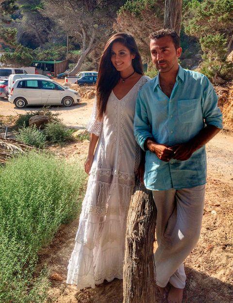 Dress, Love, Gown, Family car, Wedding dress, Waist, Parking, One-piece garment, Honeymoon, Full-size car,