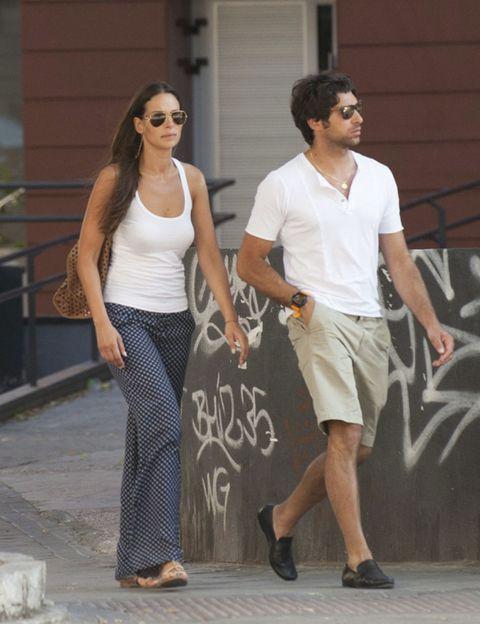 Clothing, Footwear, Eyewear, Leg, Human body, Shirt, Standing, Joint, White, T-shirt,