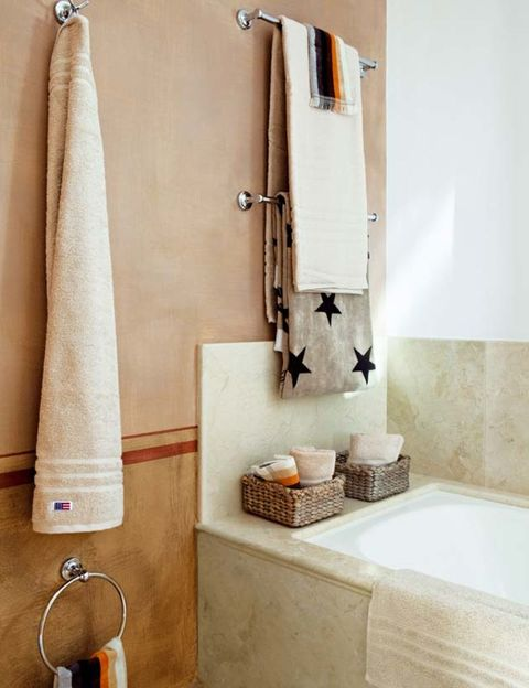 Room, Wall, Household supply, Shower curtain, Towel, Bathroom accessory, Beige, Plumbing fixture, Bathroom, Household hardware,