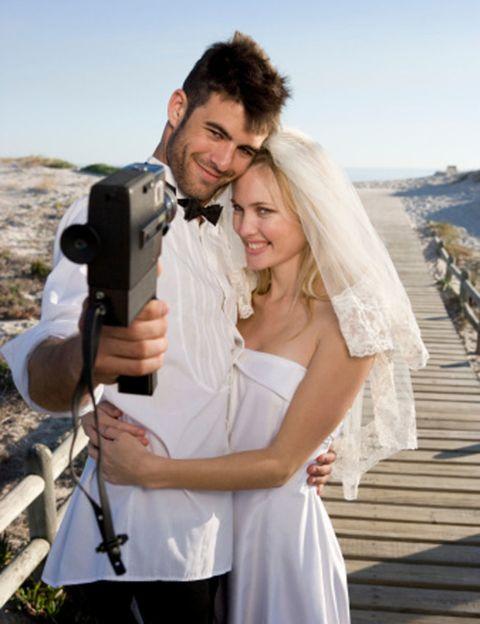 Clothing, Face, Dress, Photograph, Bridal veil, Happy, Camera accessory, Bridal clothing, Veil, Bride,