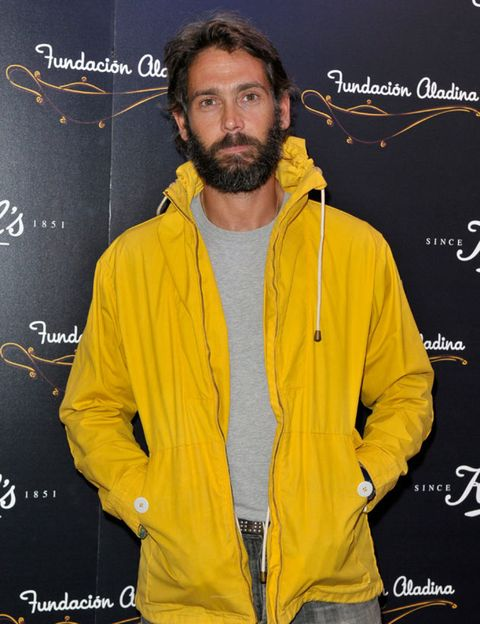 Jacket, Yellow, Sleeve, Facial hair, Textile, Collar, Beard, Moustache, Street fashion, Zipper,