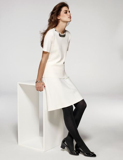 Sleeve, Collar, Shoulder, Shoe, Human leg, Joint, White, Standing, Style, Formal wear,