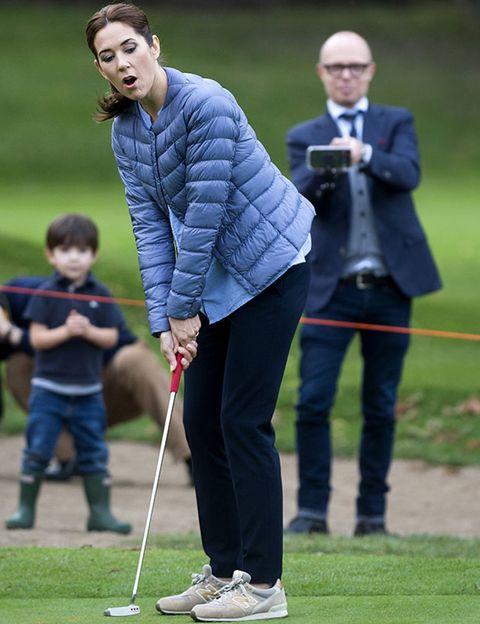 Leg, Trousers, Standing, Ball game, Golfer, Playing sports, Golf equipment, Golf club, Golf course, Blazer,