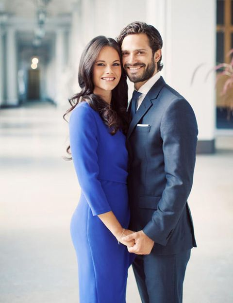 Blue, Smile, Sleeve, Coat, Collar, Standing, Outerwear, Happy, Dress, Formal wear,