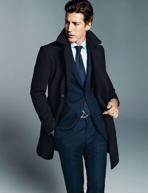 Clothing, Coat, Dress shirt, Collar, Sleeve, Human body, Trousers, Shoulder, Pocket, Standing,