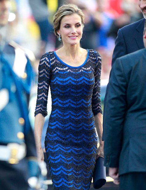 Face, Dress, Coat, Outerwear, Facial expression, Style, Suit, Electric blue, One-piece garment, Cobalt blue,