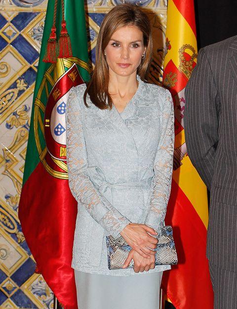 Textile, Flag, Long hair, Makeover, Government, Fashion design, Day dress, One-piece garment, Belt, Embellishment,